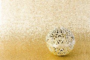 Christmas ball on gold glitter