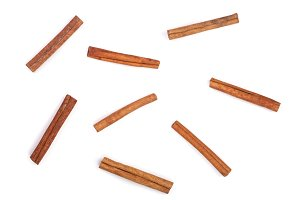 Cinnamon sticks isolated on white background, top view. Flat lay pattern