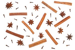 Composition of star anise, cinnamon sticks and clove isolated on white. Abstract pattern flat lay, top view