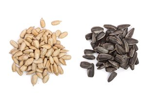 peeled and unpeeled seeds isolated on white background. Top view