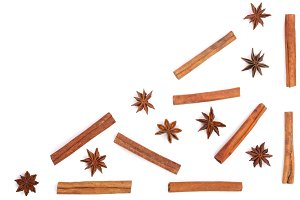 star anise and cinnamon sticks isolated on white background with copy space for your text, pattern flat lay, top view