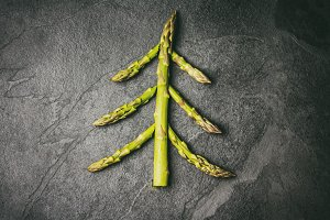Food background. Christmas tree made from asparagus Healthy holi