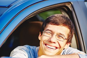 Smiling guy in car