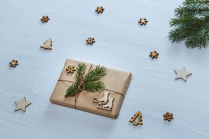 Christmas composition. Christmas gifts, fir branches, and decorative stars, snowflakes, fir trees on blue desk. Flat lay, top view