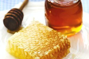 Honeycombs with honey, honey in jar