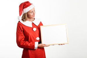 Blonde woman in Santa Claus clothes