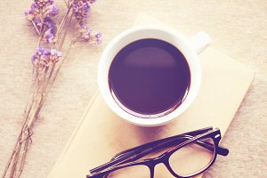 coffee on notebook and eyeglasses