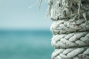 Marine rope on blue sea background