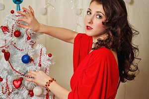 Girl near Christmas tree.