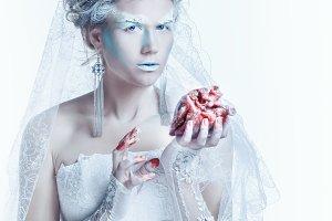 Snow queen hold heart in hands