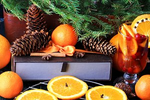 Christmas composition of preparation for drying oranges hot drink with cinnamon, anise tangerine cranberry fir vintage style on old wooden background
