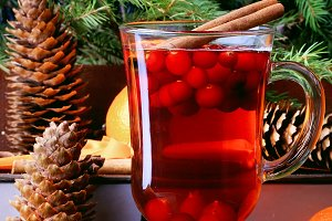 Christmas hot drink with cranberries and cinnamon fir mandarin oranges winter holiday