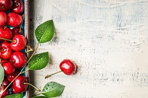 Sweet cherries with leaves, close up