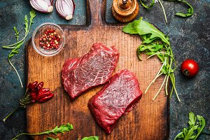 Beef steak on vintage cutting board