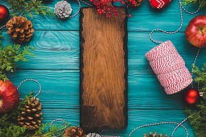 Christmas green background with wooden board