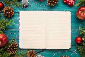 Open notebook on christmas background