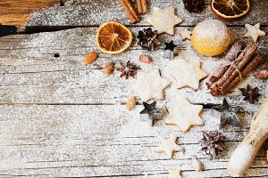 Christmas gingerbread cookies stars on a wooden table and cookie cutters, selective focus