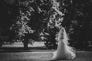 Black and white phoro beautiful brunette bride on a walk in park