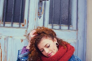 Redhead woman with winter clothes