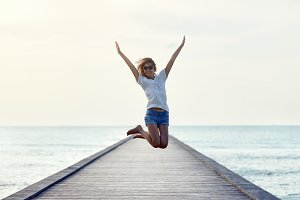 jumping girl on the pier