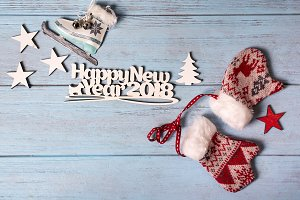 Happy 2018 New Year card with ice skates and mittens