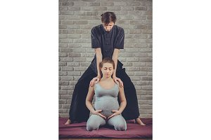 Traditional Thai Massage of a pregnant woman