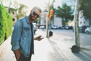 Hipster guy using smartphone
