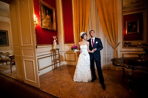 Gorgeous newleweds stand in red room