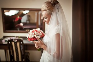 Delicate veil covers bride`s