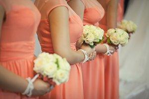 Bridesmaids in peach dressed