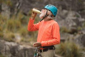 Senior man having energy drink