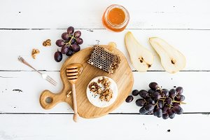 Camembert cheese with grape, walnuts, pear and honey
