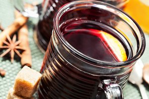 Christmas drink: mulled wine with spices  in glass cups