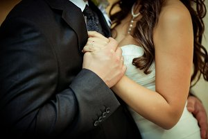 Close-up newlyweds hands