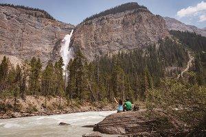 Couple looking at beautiful waterfall