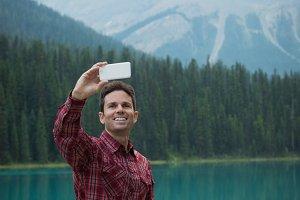 Man taking a selfie near the lake
