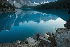 Man standing near lake side