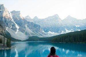 Woman sitting near lake side