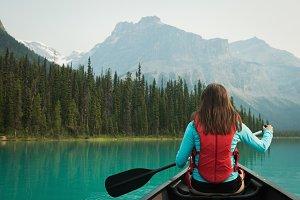 Woman kayaking in lake