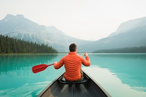 Man kayaking in lake