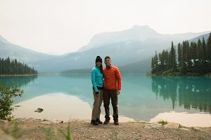 Hiker couple standing near the lake
