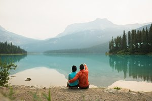 Hiker couple sitting near the lake
