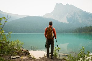 Rear view of hiker standing near the lake