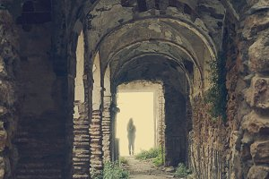 woman at the end of the ruins in the light