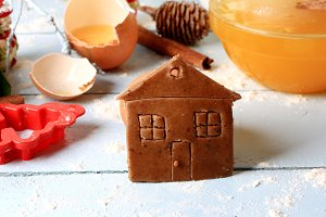 ginger cookies small house  Christmas homemade cakes on a light wooden background selective soft focus rustic style