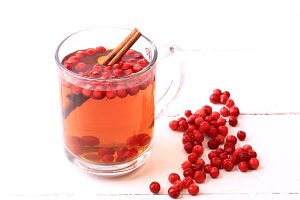 tea with cranberry and cinnamon on a white wooden background Christmas