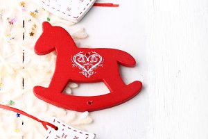xmas composition Christmas card wooden toys on a white wooden background heart horse fir new year winter