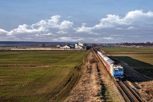 Train on a field in Romania