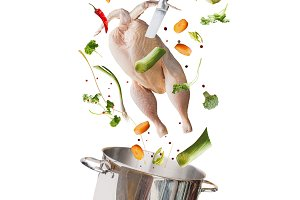 Raw whole chicken and cooking pot
