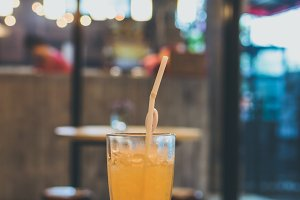 Glass of fresh orange juice with ice. Cafe. Bali island, Indonesia.